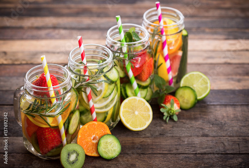 Vászonkép Fresh detox water with fresh fruits, vegetables and herbs