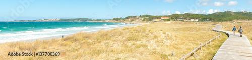Walk through the dunes of the beach A Lanzada in O Grove.
