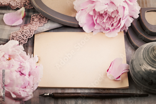 Nostalgic Background with Paper, Spring Flowers and Pen on Wooden Deck