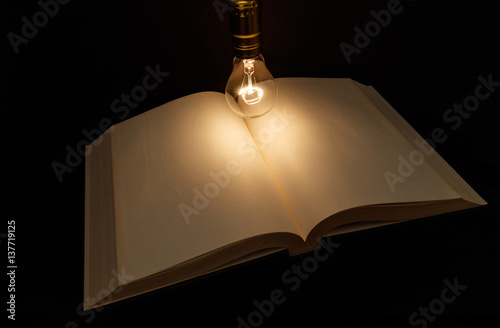 Photo  book and light bulb