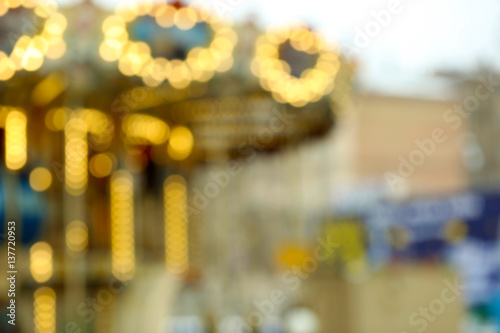 Poster Attraction parc Carousel unfocused lights