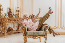 Joyful Old Lady Enjoying Luxur...