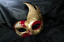 Red And Gold Mask With Flare On Black Satin