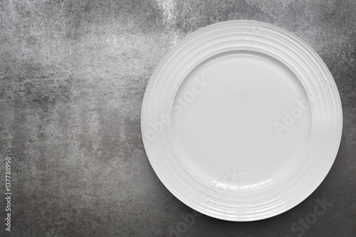 Fotografie, Obraz  Empty White Plate over Gray Slate Top View