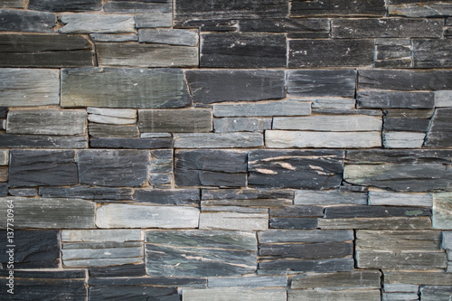 Stone wall texture with black gray blue and white bricks