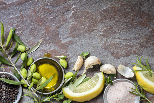 Food Background with Olives, Oil, Lemon, Garlic, Herbs and Spices