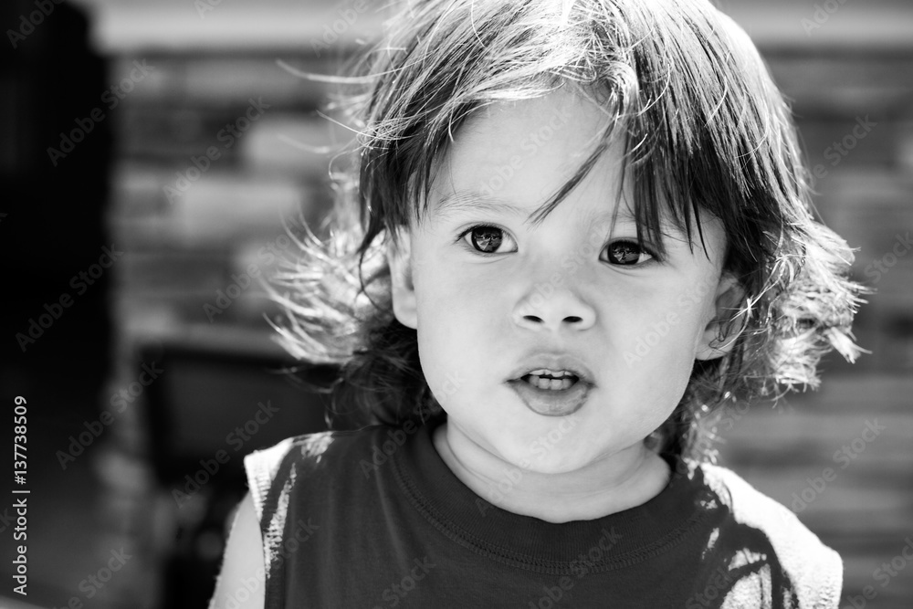 Fototapeta Portrait of a boy outdoor in black and white