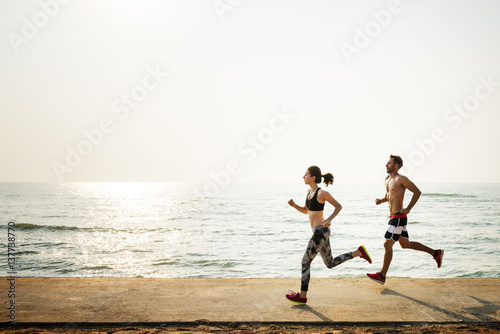 Foto auf Leinwand Jogging Running Exercise Training Healthy Lifestyle Beach Concept