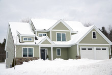 Residential House After Snow Storm In Winter