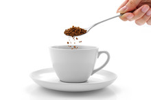 Hand Pours Instant Coffee From...
