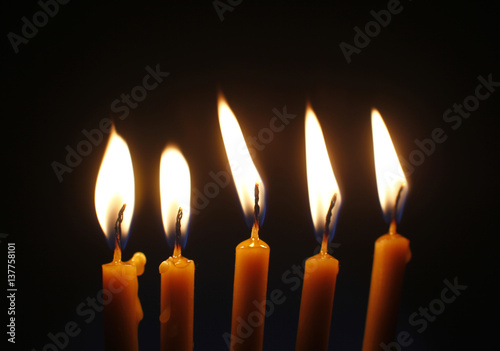 фотография Five burning candles on black background