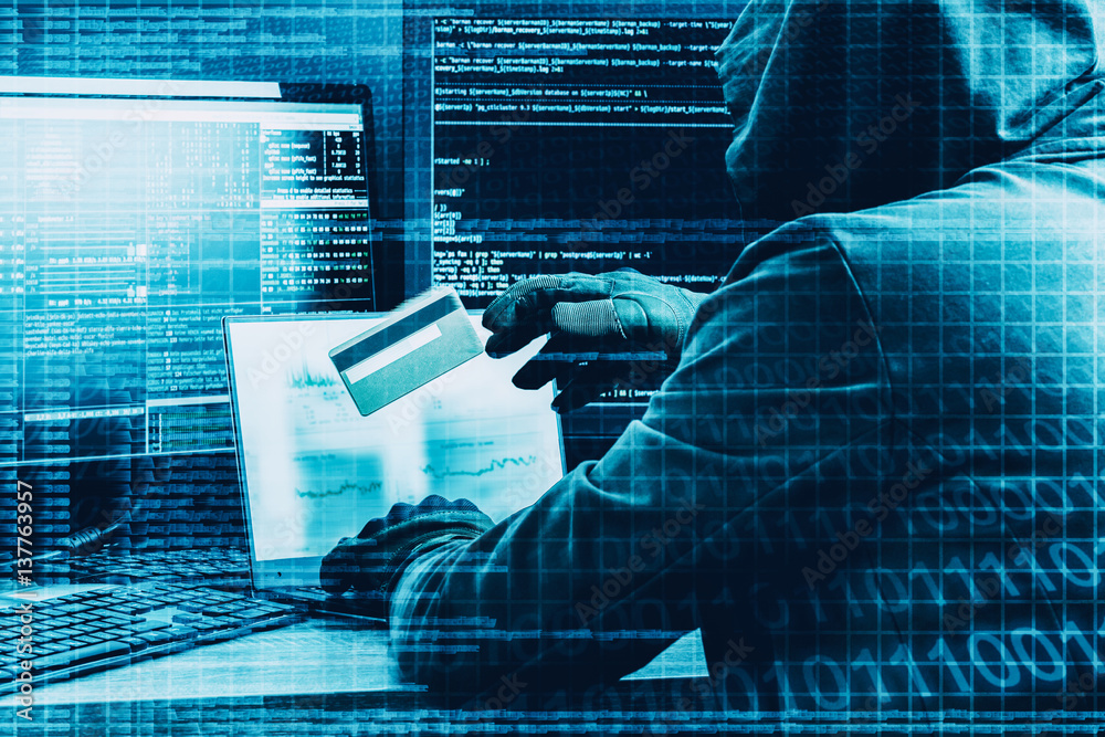Fototapeta Internet crime concept. Hacker working on a code and stealing credit card with digital interface around.