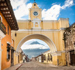 Arco de Santa Catalina and colonial houses in tha street view of Antigua, Guatemala.