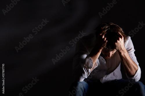Fotografie, Obraz Schizophrenic man holding his head