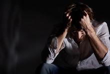 Man Suffering Emotional Pain
