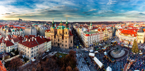 Fotobehang Praag Old Town of Prague, Czech Republic. View on Tyn Church and Jan Hus Memorial on the square as seen from Old Town City Hall. Blue sunny sky