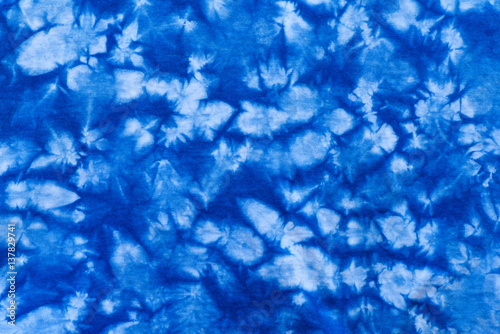 Fotografie, Obraz  Pattern of blue tie batik dye on cotton cloth, Dyed indigo fabric background and