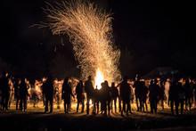 People Dancing Around A Bonfire