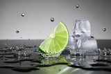 Lime with water drops and ice cubes