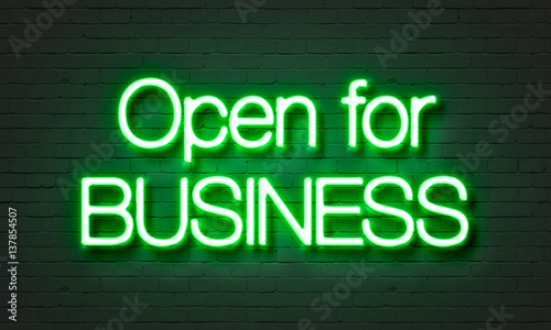 Fotografia, Obraz  Open for business neon sign on brick wall background.