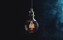 Vintage Lightbulb On Dark Back...