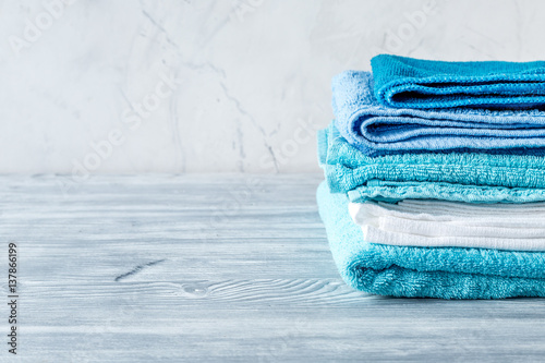 Fotografie, Obraz  Towels set in laudry on gray table backgruond mock-up