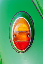 Close-up Tail Lamp Of Classic Beetle Green The Popular German Car Manufacture.