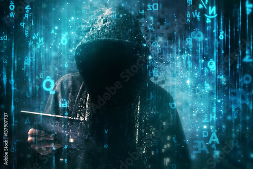 Computer hacker with hoodie in cyberspace surrounded by matrix code