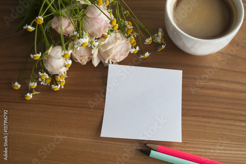 Fotografie, Tablou  Rose and daisy bouquet with coffe and sticker and pencils