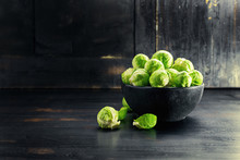 Ingredients Brussels Sprout  On Black Wooden Table. Selective Focus