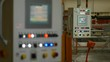 Large Control Device Panel with Buttons in Workshop