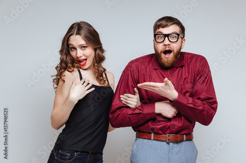 Photo  Funny Woman holding hand of Shocked Male nerd