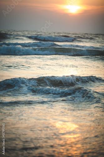 Beautiful sunset over the ocean. Sunrise in the sea. - 137951165