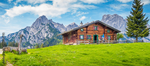 Aluminium Prints Blue Traditional wooden mountain chalet in alpine mountain scenery