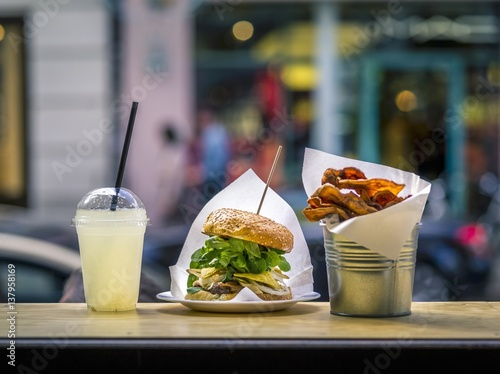Fotobehang Restaurant A burglar, lemonade and chips in a fast food restaurant
