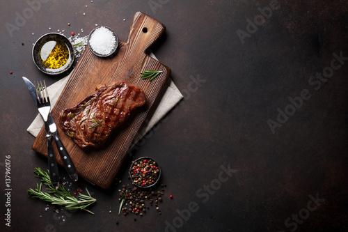 Staande foto Vlees Grilled ribeye beef steak, herbs and spices