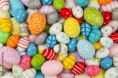 easter background with many colorful painted decorated eggs