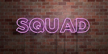 SQUAD - Fluorescent Neon Tube Sign On Brickwork - Front View - 3D Rendered Royalty Free Stock Picture. Can Be Used For Online Banner Ads And Direct Mailers..
