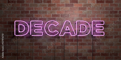 Tablou Canvas DECADE - fluorescent Neon tube Sign on brickwork - Front view - 3D rendered royalty free stock picture