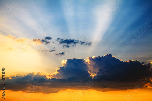 Foto op Canvas Koraal Colorful sunset with rays