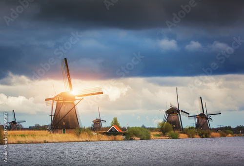 Windmills against cloudy sky at sunset in famous Kinderdijk, Netherlands Canvas Print