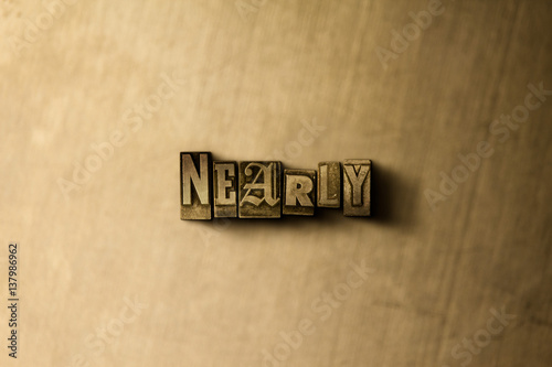 Fotografie, Obraz  NEARLY - close-up of grungy vintage typeset word on metal backdrop