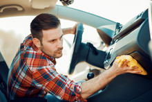 Young Man Cleaning Car Interior