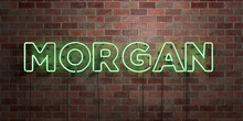 MORGAN - Fluorescent Neon Tube Sign On Brickwork - Front View - 3D Rendered Royalty Free Stock Picture. Can Be Used For Online Banner Ads And Direct Mailers..