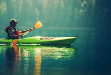 Senior Kayaker On The Lake