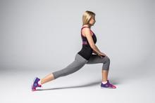 Happy Girl Doing Fitness Exercises Over White Background