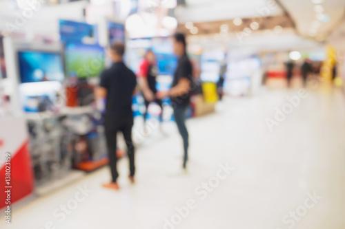 Zdjęcie XXL Telewizyjna półka w eletronic wydziałowym sklepie zamazywał tło