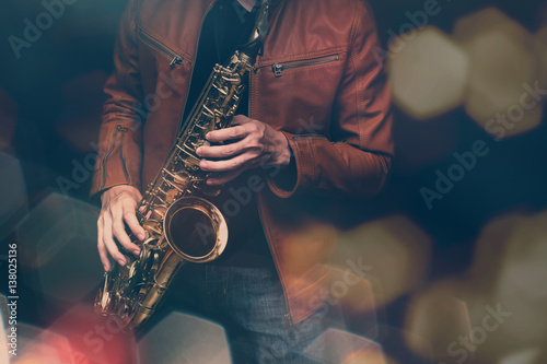 Photo  Jazz saxophone player in performance on the stage