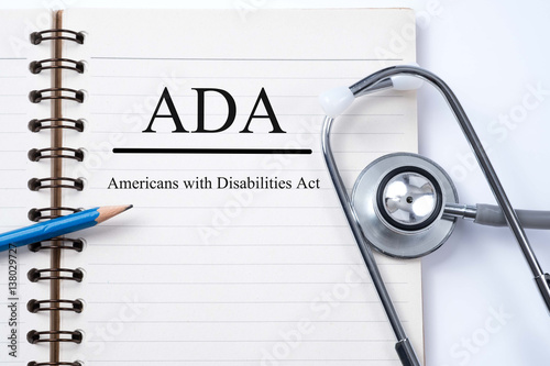 Stethoscope on notebook and pencil with ADA (Americans with Disabilities Act) words as medical concept Wallpaper Mural