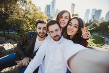 A Group Of Young Good Looking Multiethnic Hipster Friends Taking Selfie Self-portrait In Central Park, New York. Mixed Race Students Have Fun And Take Photo For Travel